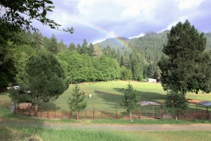 rainbows and clouds cover the pastures of californias dude ranch